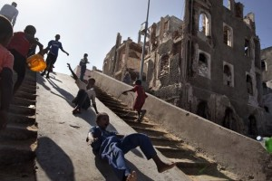 Somali children enjoy themselves using a ramp as a slide in Mogadishu, Somalia on January 27, 2014. More than 20 years of war in Somalia have left a devastated country without any basic infrastructures, where children are born and grow up surrounded by destruction wherever they go.